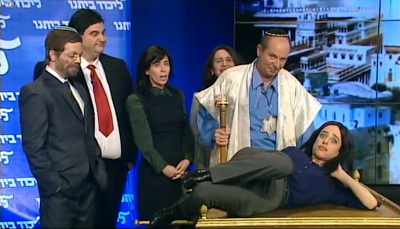In a skit on the Eretz Nehederet satire program, Ayelet Shaked of the Jewish Home is depicted as agreeing to be the victim of a &quot;Gimpel style&quot; sacrifice with nationalist members of the Likud and Jewish Home.