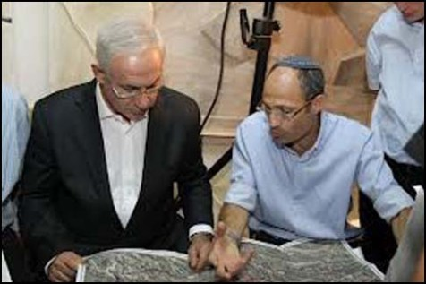 Gush Etzion Local Council Head Davidi Pearl (R) with Prime Minister Netanyahu, poring over the blueprints for the security fence.