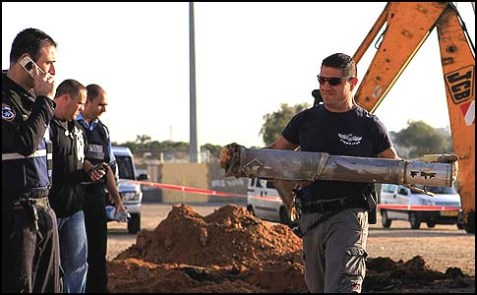 Israeli police with the remains of a rocket fired on Ashkelon, Feb. 3, 2009.