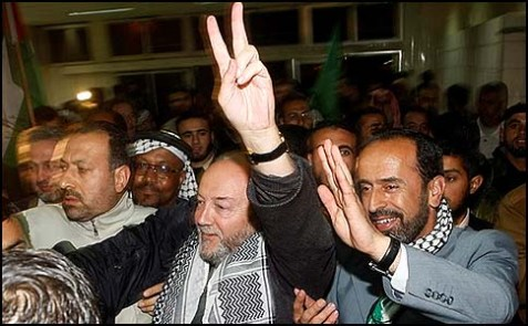 British MP George Galloway (center) arriving at the Rafah border crossing in southern Gaza, leading an international aid convoy of more than 500 activists, January 06, 2010.