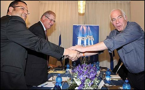 Uri Ariel, leader of the Jewish Home coalition negotiations team, shaking hands with Likud party representatives, February 03, 2013.