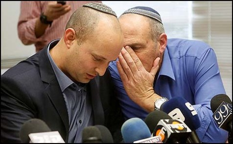 Jewish Home MK Mordechi Yogev whispering into Chairman Naftali Bennett's ear during a faction meeting in the Knesset.