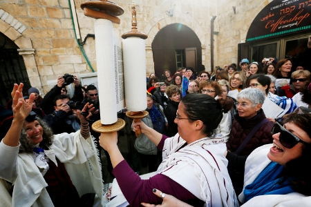 A member of Women of the Wall holds a Torah scroll outside a police station in Jerusalem earlier this year.