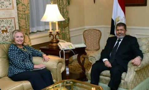 U.S. Secretary of State Hillary Clinton and Egyptian President Mohamed Morsi.