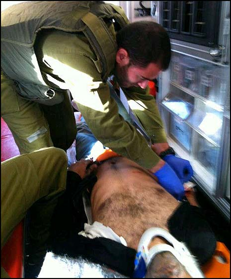 IDF paramedic treats the injured man in the ambulance. Photo: IDF