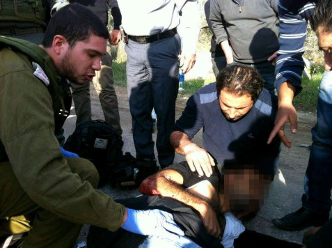 The injured Palestinian being treated by IDF paramedics