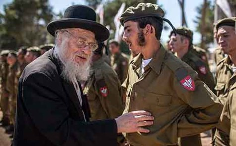 Rabbi Yoel Schwartz greets Religious Jewish soldiers attending a swearing in ceremony as they enter the IDF &quot;Nahal Haredi&quot; unit. May 31, 2012.