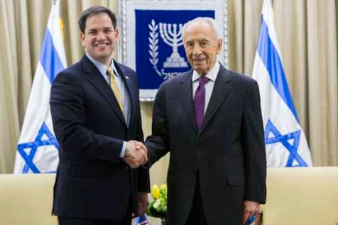 Israeli president Shimon Peres meets shake hands with U.S. Sen. Marco Rubio (R-Fl.) at the president's residence in Jerusalem. February 20, 2013.
