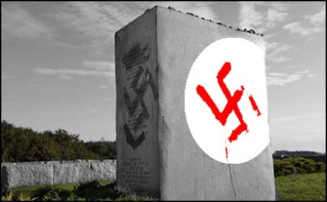 Vandalized monument commemorating a pogrom in Jedwabne, Poland.