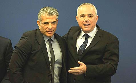 Outgoing Finance minister Yuval Steinitz (R) introducing his successor Yair Lapid. Steinitz, the Likud party and Netanyahu may regret giving Lapid this post.