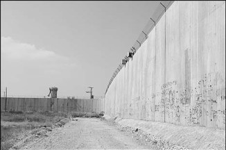 Here's the security wall Israel erected alongside the West Bank and Gaza. It turns both sides into prisons.