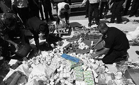 Hamas Police with Confiscated Drugs.