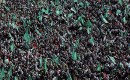 Tens of thousands attended a mass rally to celebrate the 23rd anniversary of the founding of the Islamic movement Hamas in Gaza City.
