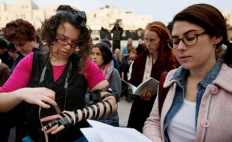 Practice makes perfect… A WOW worshipper at the Kotel having a hard time getting those straps to line up. Where's a Chabadnik when you need one?