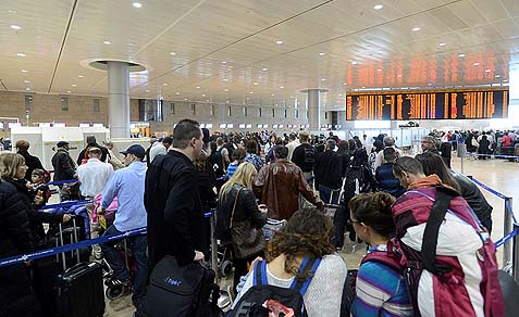 Thousands of Israelis stood in line at Ben Gurion International Saturday night, attempting to get out of the country before the 5 AM strike.
