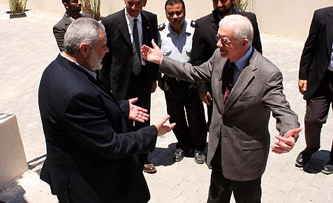 Former U.S. President Jimmy Carter (R) about to embrace Hamas chief Ismail Haniyeh (L), in Gaza City, as the two discussed ending the international boycott of the Islamic, anti Israeli and anti American terrorist organization.