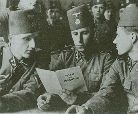Muslim Waffen SS soldiers reading a pamphlet by the Mufti of Jerusalem Haj-Amin el-Husseini.