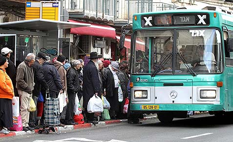 Passengers waiting to board an Egged bus in the center of Jerusalem.