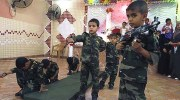 Palestinian kindergarten children enacting a military operation.