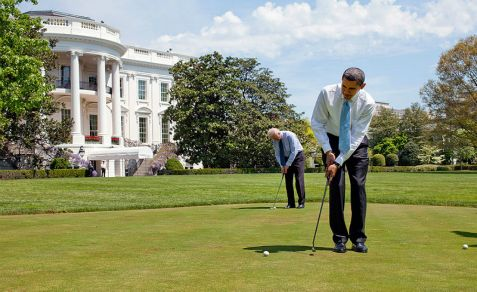 .Obama and Biden on White House putting green.
