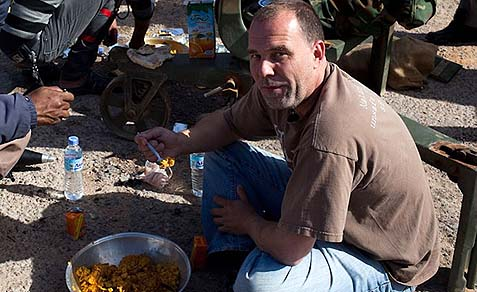 "Peter Bouckaert, emergencies director of Human Rights Watch, having lunch. Peter likes long walks on the beach with fellow ""insider"" correspondents and dumping on Israel."
