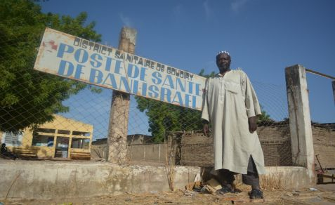 Dougoutigo Fadiga outside the Bani Israel clinic near the Senegalese village's sacred tree