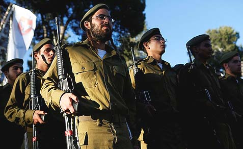 Religious Jewish soldiers attending an IDF swearing-in ceremony.