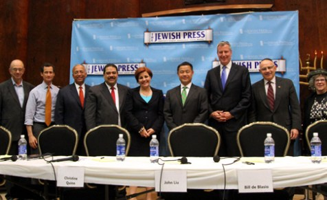 Jerry Greenwald (far left) and Naomi Klass Mauer (far right) of The Jewish Press with Democratic candidates for mayor (L-R) Anthony Weiner, Bill Thompson, Erick Salgado, Christine Quinn, John Liu, Bill de Blasio, and Sal Albanese. (Photo by Shimon Golding for The Jewish Press)