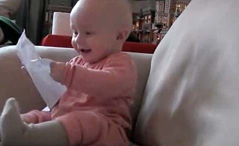baby ripping paper