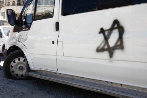 Car with the Jewish Star of David spray painted on it, following a Price Tag vandalism event in Beit Hanina on June 24, 2013.