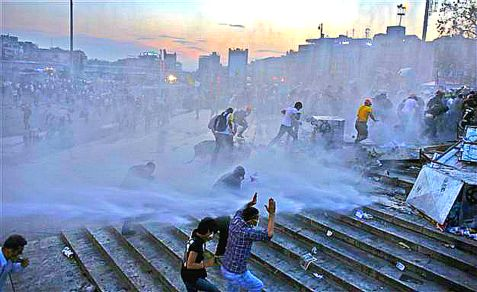Protesters in Istanbul Taksim Square reel from police rubber bullet and tear gas attacks