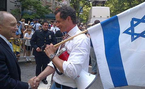 Mayoral candidate Anthony Weiner (D, with flag) with potential mayoral candidate, Commissioner Ray Kelly (R).