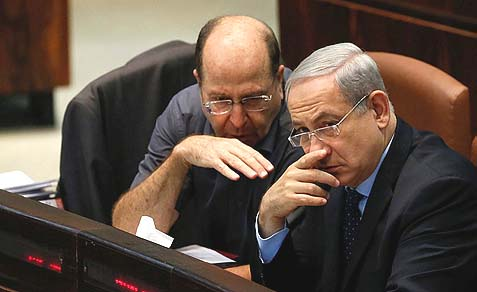 Israeli Prime Minister Benjamin Netanyahu (R) and Defense Minister Moshe (Bogie) Yaalon are showing with their actions the value they attribute to innocnet Jewish lives.
