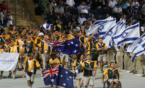 Athletes from the Australian delegation wave their national flags during the opening ceremony of the Maccabiah Games in Jerusalem for the 19th Maccabiah Games, dubbed the 'Jewish Olympics'