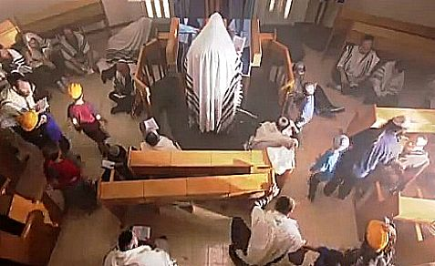 Temple Mount Institute video scene of children taking adults out of synagogue on Tisha B'Av to start rebuilding the Holy Temple