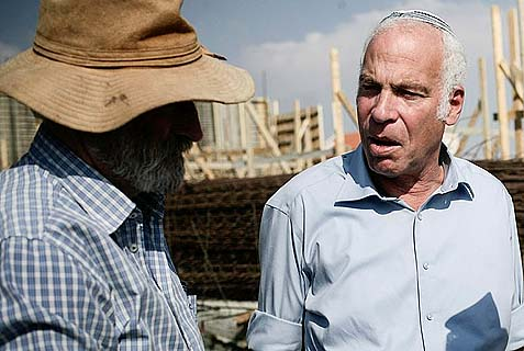 Israeli Housing Minister Uri Ariel (R, Jewish Home) with Yesha leader Ze'ev Chever (Zambish), at the new Jewish town of Tel Tzion, near Jerusalem, August 13, 2013. The left has picked Minister Ariel as the focal point of an effort to oust pro-settlement voices from the Netanyahu coalition.