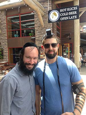 Ben from San Francisco put on tefillin for the first time in his life. Photo credit: Chabad.org
