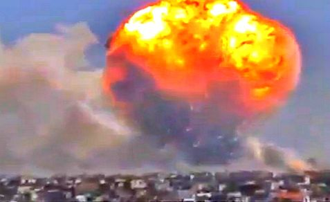 Huge ball of flame and smoke rise over Syrian army ammunition depot in Homs after rebel rocket attack