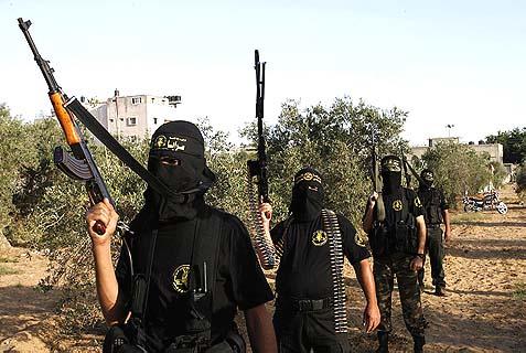 """Masked recruits of the Islamic Jihad military wing """"Saraya Al-Quds"""" or """"Jerusalem Brigades"""" strutting their stuff."""