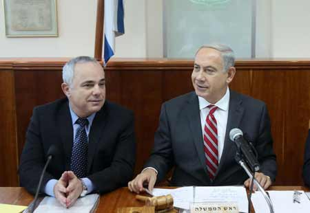 Israeli Prime Minister Benjamin Netanyahu (right) with the country's  minister of intelligence, Yuval Steinitz, during the weekly cabinet meeting, at Netanyahu's office in Jerusalem on October 13. (Photo by Marc Israel Sellem/POOL/Flash90)