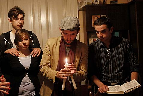 Young Jewish students at a Jewish Community Center (JCC) in Krakow, Poland, during a havdalah ceremony.