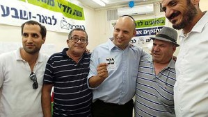Minister of Economics and leader of the Jewish Home party Naftali Bennett in a photo op with party ops in Lod, one of the Jewish Home wins last night.