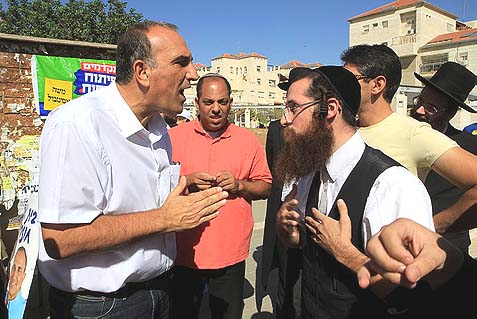 Israelis of various stripes and religious convictions arguing in Beit Shemesh during the recent municipal campaign that ended up fraught with accusations of fraud and corruption.