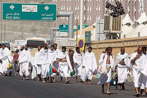 Muslims on the Hajj. The arrow points to a few of the many thousands of tents set up for the pilgrims
