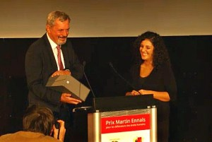 Chair of the jury for the Martin Ennals Human Rights Award Hans Thoolen, left, hands an award to finalist Mona Seif during the Oct. 8, 2013 ceremony in Geneva.