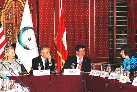 "Then-Secretary of State Hillary Clinton (L), Secretary-General of the OIC Ekmeleddin İhsanoğlu (2nd L), Turkish Foreign Minister Ahmet Davutoglu (3rd L) and EU High Representative Catherine Ashton (4th L) participate in the OIC conference on ""Building on the Consensus"" in Istanbul, Turkey, on July 15, 2011."