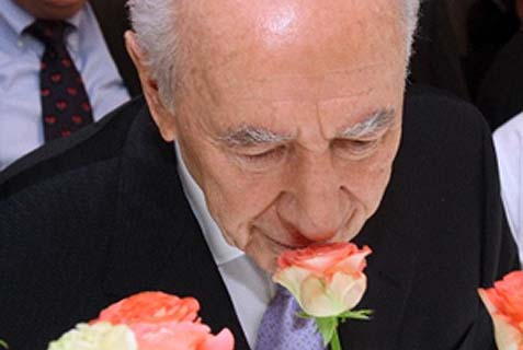 "Israel's President Peres, ""Mr. Optimism,"" can smell flowers even where there are none to be found."