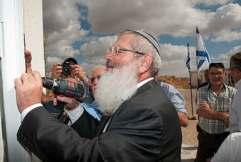 Deputy Religious Affairs Minister Rabbi Eli Ben-Dahan affixes mezuzah to a cultural center.