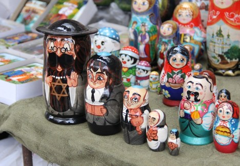 "The Jewish motif is not far from the surface of Ukraine. Sometimes it is antisemitic, and other times it is portrayed as an intersection between the Russian/Ukrainian culture and the Jewish culture that grew there. These are matryoshka dolls, also known as Russian nesting/nested dolls, that is, a set of wooden dolls of decreasing size placed one inside the other. They are sometimes referred to as ""babushka dolls"" (grandmother doll). They can come in many themes, including this Jewish set."