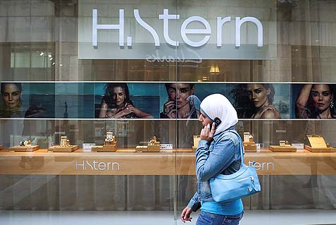 An Arab woman in a headscarf walking past the H. Stern jewelry store at the Mamilla Mall in Jerusalem.